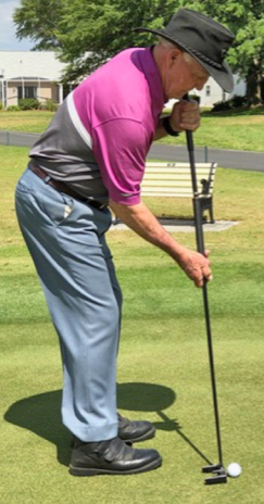 Side-saddle putting with a long putter